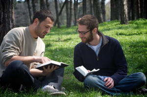 Two_people_reading_Bible